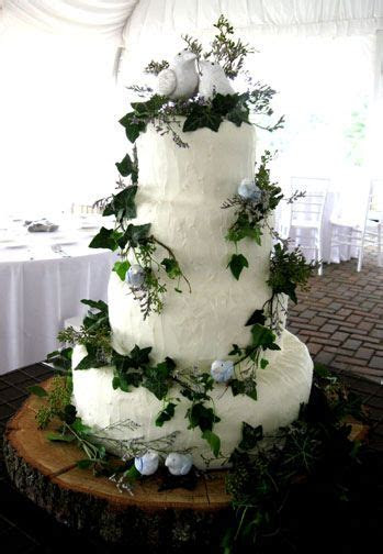 Nature theme with ivy, birds, and tree wedding cake. I
