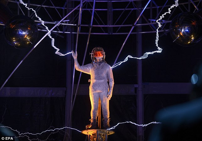 Bolts of electricity: David Blaine stepped out onto Pier 54 in New York City tonight where he stood amidst a million volts of electricity