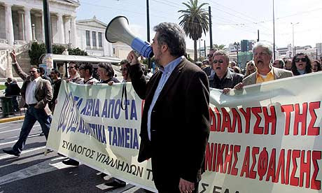 Striking bank workers demonstrate in Athens yesterday