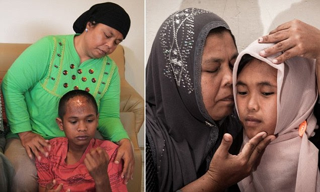 Indonesian mother Jamaliah is reunited with her missing son Arif Pratama Rangkuti in Payakumbuh town on Sumatra island on August 19, 2014. The Indonesian boy was swept away by the devastating 2004 tsunami and has been reunited with his family a decade after he was given up for dead. His sister Raudhatul Jannah was also reunited with her family on August 7, 2014.  Arif and her sister Raudhatul Jannah were carried off when huge waves struck their home in West Aceh district on December 26, 2004. AFP PHOTOAFP/AFP/Getty Images