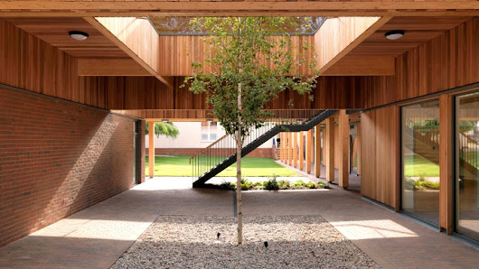Colonnades and courtyards bring nature into sixth form centre by IF_DO