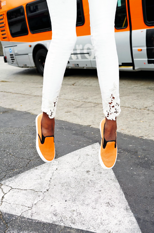 LE FASHION BLOG SPRING LOOK CROCHET DENIM AND BRIGHT SNEAKERS ASOS MAGAZINE 2014 SKINNY WHITE JEANS WITH CROCHET DETAIL ANKLES ORANGE SLIP ON SNEAKERS WITH BLACK PIPING photo LEFASHIONBLOGSPRINGLOOKCROCHETDENIMANDBRIGHTSNEAKERSASOSMAGAZINE2014.png