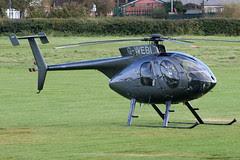 G-WEBI - 1999 build Hughes 369E, visiting Barton