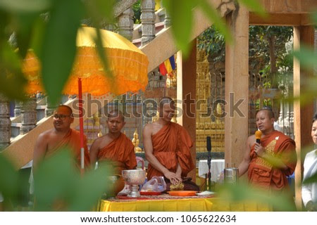 Phnom Penh, Cambodia – February 01, 2018: Four Buddhist Monks were looking over the celebration from behind the table.