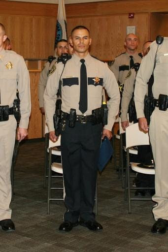 In this Oct. 31, 2013 photo released by Dona Ana County Sheriff shows officer Jose Chavez at his graduation ceremony from our Law Enforcement Academy in Las Cruces, N.M. Hatch Police Officer Jose Chavez, 33, was gunned down during a traffic stop Friday, Aug. 12, 2016. Chavez was shot in the neck and airlifted to University Medical Center in El Paso, Texas, where he later died. Authorities don't yet know why a New Mexico police officer in a small village famous for its green chile and not much more pulled over two Ohio murder suspects before being gunned down. (Dona Ana County Sheriff via AP)
