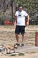 robert pattinson takes his pet pooch to the dog park 04