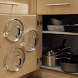Use Adhesive Hooks to Organize Your Pot Lids and Save Cabinet Space