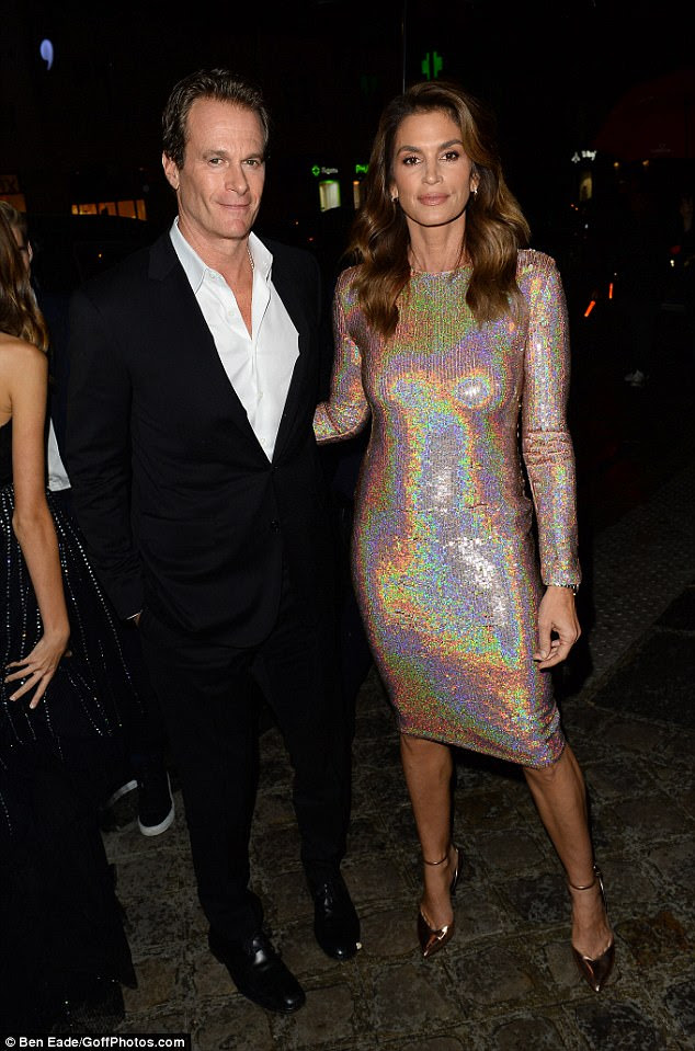 Glitter girl: The happy couple looked chic in their respective ensembles