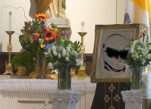 Funeral for a Stig, image showing Stig helmet at a funeral setting