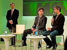 Eric Schmidt, Sergey Brin, and Larry Page sitting together