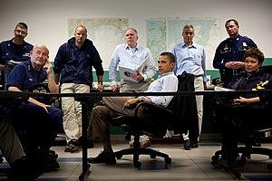 President Barack Obama listens during a briefi...