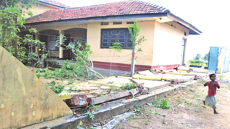 A damaged parapet wall of the Karaitivu Agrarian Services Centre. Picture by I. L. M. RIZAN, Addalaichenai Central Corr.