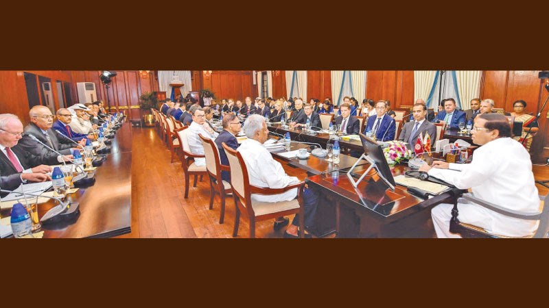President Maithripala Sirisena held a meeting with Ambassadors and High Commissioners in Sri Lanka at the Presidential Secretariat on Monday. Ministers Dr. Sarath Amunugama and Mahinda Samarasinghe and former Minister Prof. G. L. Peiris were present. Picture by President's Media Division.