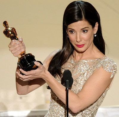Sandra Bullock shows off the Oscar trophy that she won for Best Actress on THE BLIND SIDE.