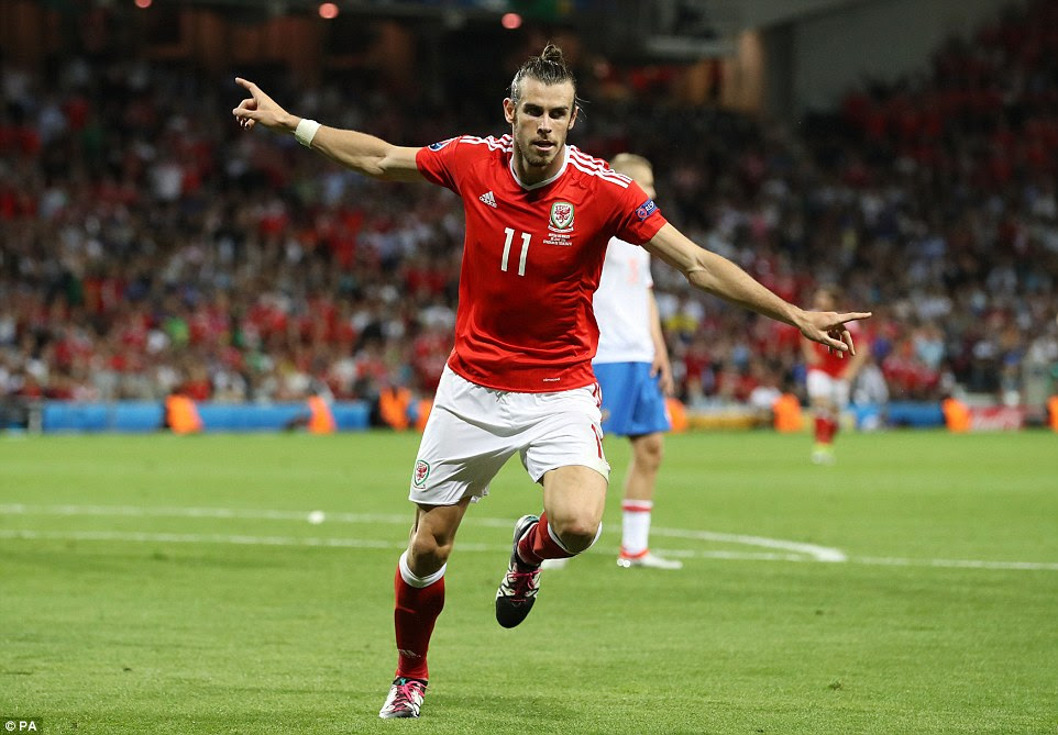 Bale spreads his arms to celebrate his goal - it was his third of the tournament, which made him Euro 2016's current top goalscorer