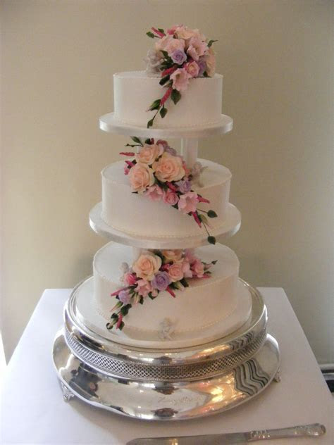 Grace, classic royal iced and pillared wedding cake with