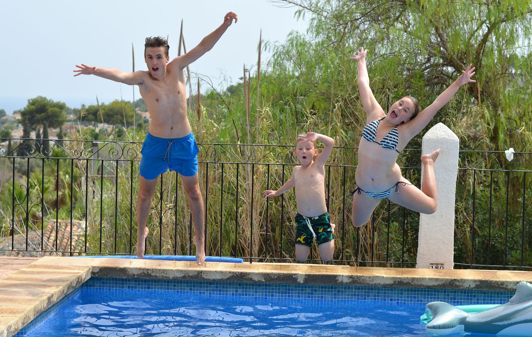 photo kids jumping in pool_zpsco61g8es.jpg