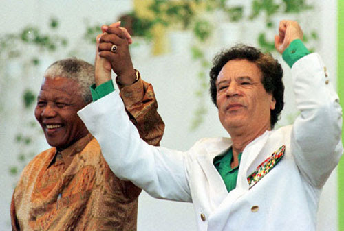 Former South African President Nelson Mandela and Libyan leader Muammar Gaddafi joined hands to the racist apartheid system in the sub-continent. Mandela was released from prison in 1990 after 27-and-one-half years. by Pan-African News Wire File Photos