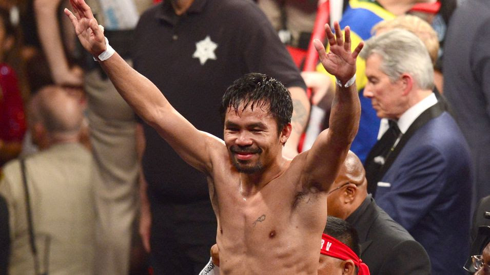 Manny Pacquiao reacts after his fight against Floyd Mayweather Jr. in a welterweight unification bout on May 2, 2015 at the MGM Grand Garden Arena in Las Vegas, Nevada. AFP PHOTO / FREDERIC J. BROWN        (Photo credit should read FREDERIC J. BROWN/AFP/Getty Images)