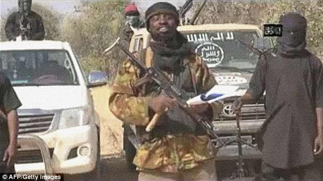 The images come just days after Boko Haram were suspected of kidnapping at least 30 children, including girls as young as 11, in a village north of the country; a week earlier the terrorists snatched around 40 women in Adamawa State; Boko Haram leader Abubakar Shekau, is pictured above, delivering a message