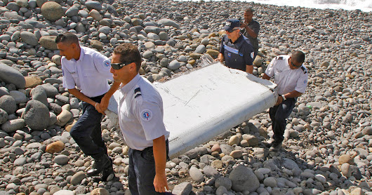 Flight 370 search: Investigators analyze 777 wing flap