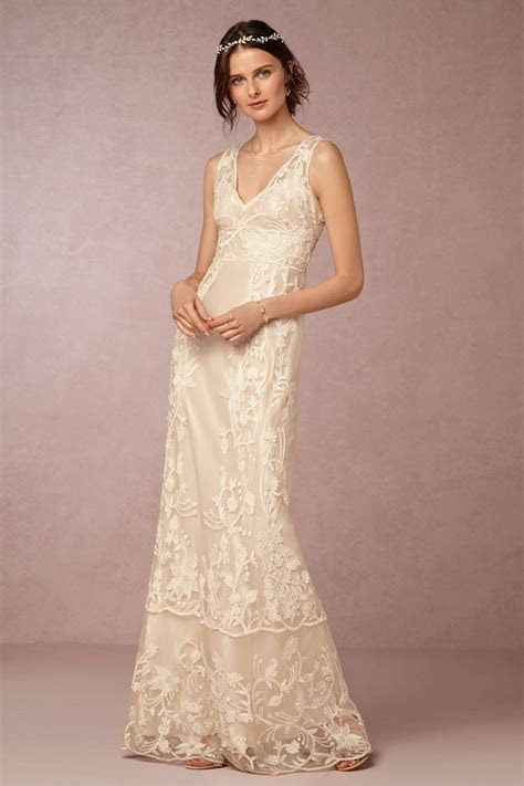 embroidered lace wedding dress perfect for a backyard