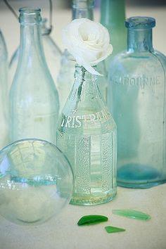 coastal vintage bottles and sea glass