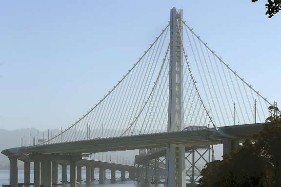 Views of the new Bay Bridge tower in the background seen from Treasure Island in San Francisco, Calif., on Wednesday, September 23, 2015.  Caltrans will soon change contractors to maintain and fix the new span of the Bay Bridge.