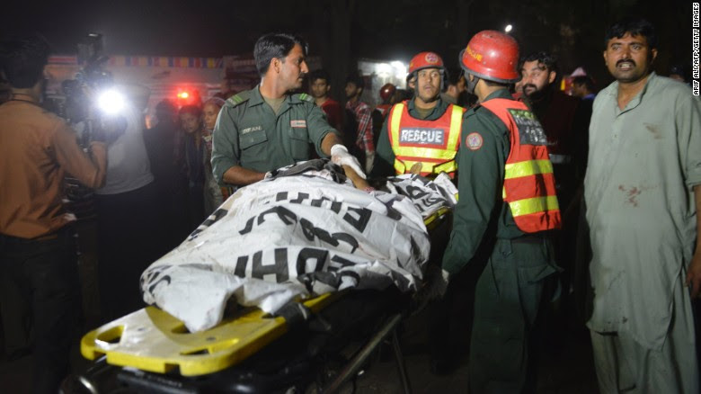 Rescuers use a stretcher to shift a body from a bomb blast site in Lahore, Pakistan, on Sunday, March 27.  A blast in Pakistan's southwestern city of Lahore has killed at least 50 people and injured 200, according to health adviser for Punjab province Khawaja Salman Rafique.