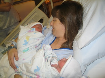 Mommy's first moments with both twins.