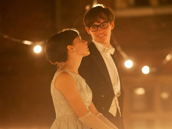 Stephen Hawking (Eddie Redmayne) and Jane Wilde (Felicity Jones) share a moment at the Cambridge May Ball in THE THEORY OF EVERYTHING.
