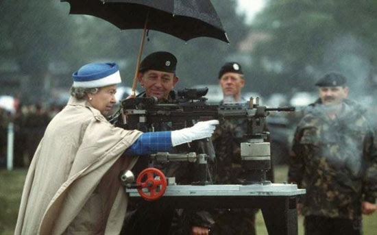 Queen Elizabeth II fires a machine gun while soldiers look on | Tacky Harper's Cryptic Clues