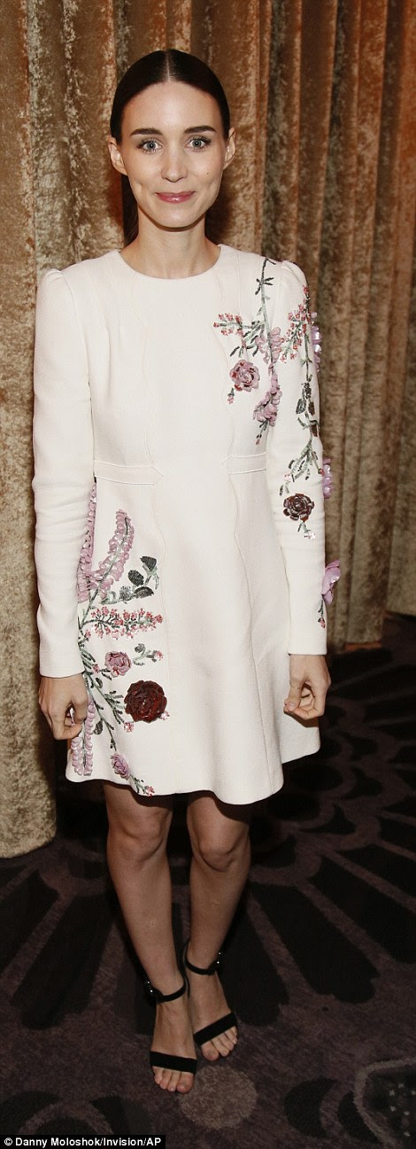 She sure is in bloom: The star, who has been recognized for her work in Carol as a Best Supporting Actress, looked striking in this white mini dress with flower embroidery on the sleeve and side