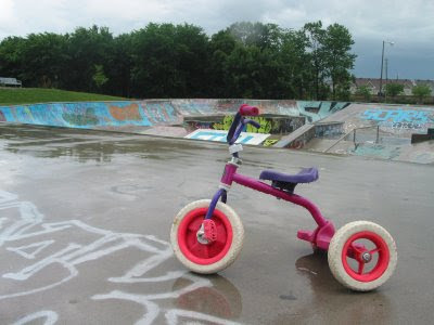 broken trike at wet skatepark