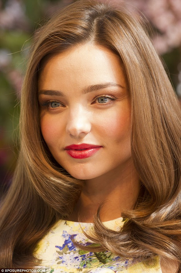 Miranda Kerr displays her famous figure in a formfitting floral shift dress as she promotes a