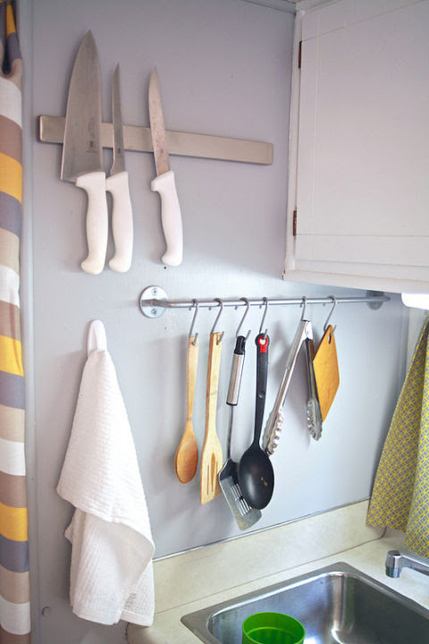 When this family embraced small-space living and moved into a 150-foot camper, they got smart about organizing. A towel bar repurposed as a place to hang spoons and spatulas turns a blank wall into a useful storage spot. See more at The Noshery »