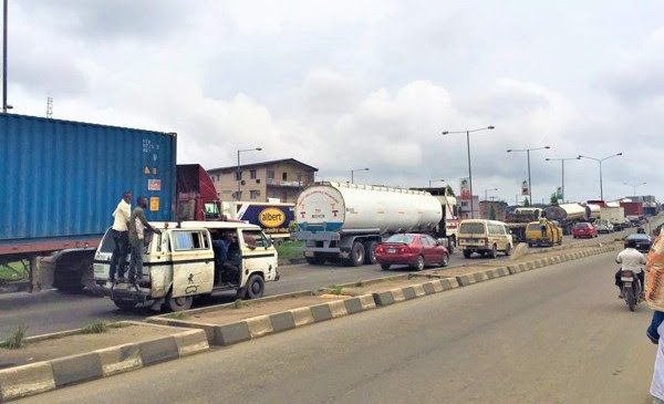 """Dear VP Osinbajo, The Parked Trucks You Ordered Off The Roads Are Still There"