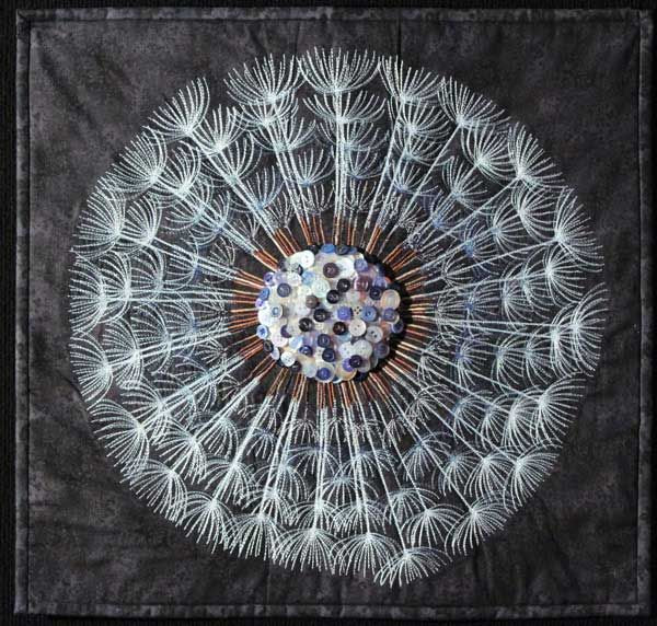"""Wish Upon a Dandelion"" by Casey Waite.  Thread painting with button center.  Judges commendation, 2013 Sydney (Australia) quilt show."