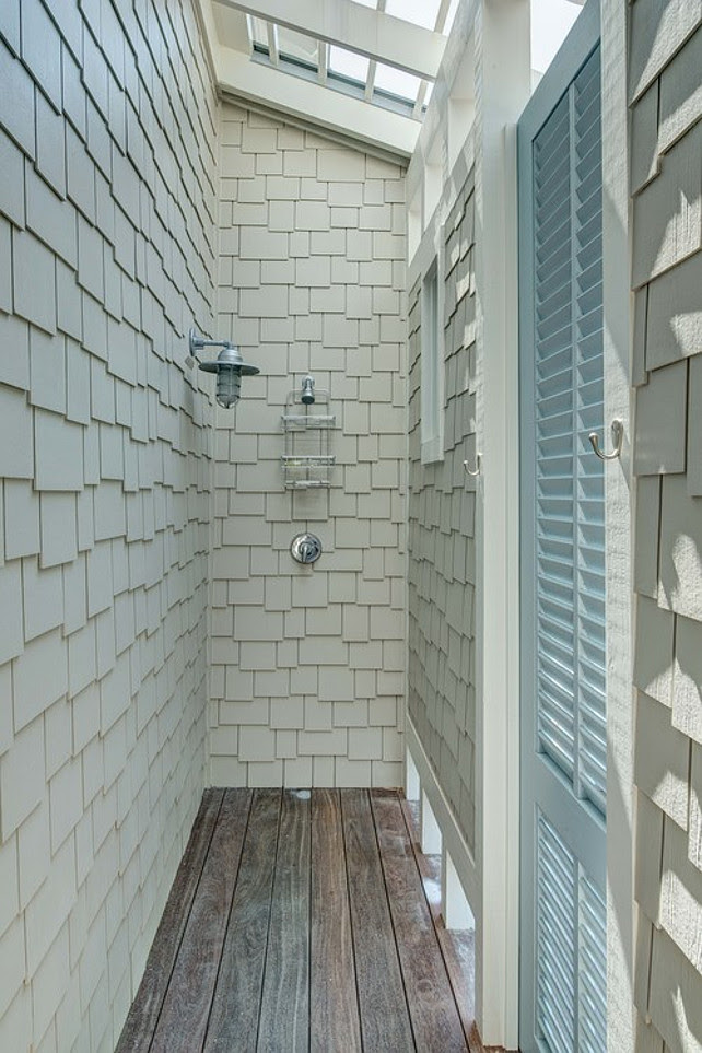 Outdoor Shoyer. Beach House outdoor shower. Beach house with outdoor shower with shingles, ipe flooring and a turquoise shutter-style door. #OutdoorShower  Christ & Associates.