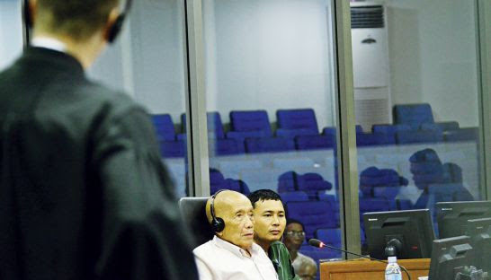 Kaing Guek Eav, alias Duch, is cross-examined at the Khmer Rouge tribunal in Phnom Penh last week. ECCC