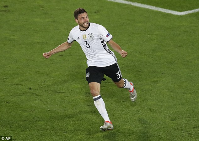 Hector wheels away in celebration after hitting the decisive penalty for Germany against Italy