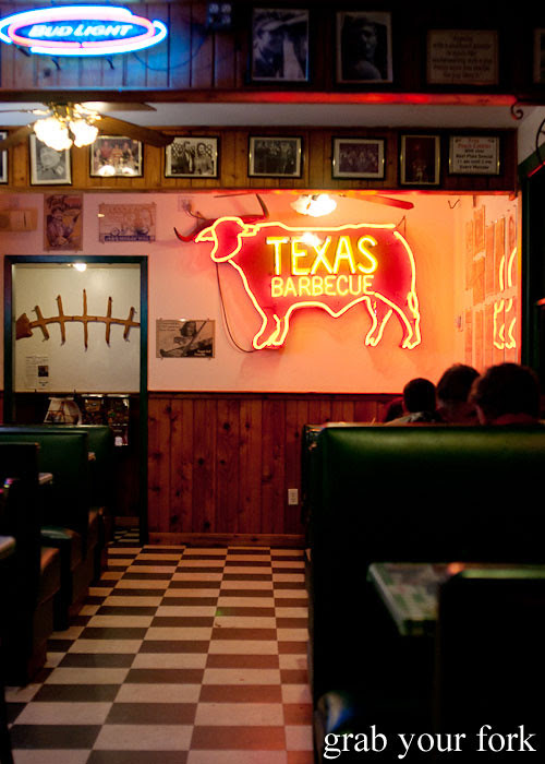 dining room booth seating and neon at green mesquite bbq austin texas