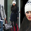 Time to head home: Cheryl Cole and boyfriend Tre Holloway leave their New York hotel weighed down with bags and head back to the UK after Christmas break