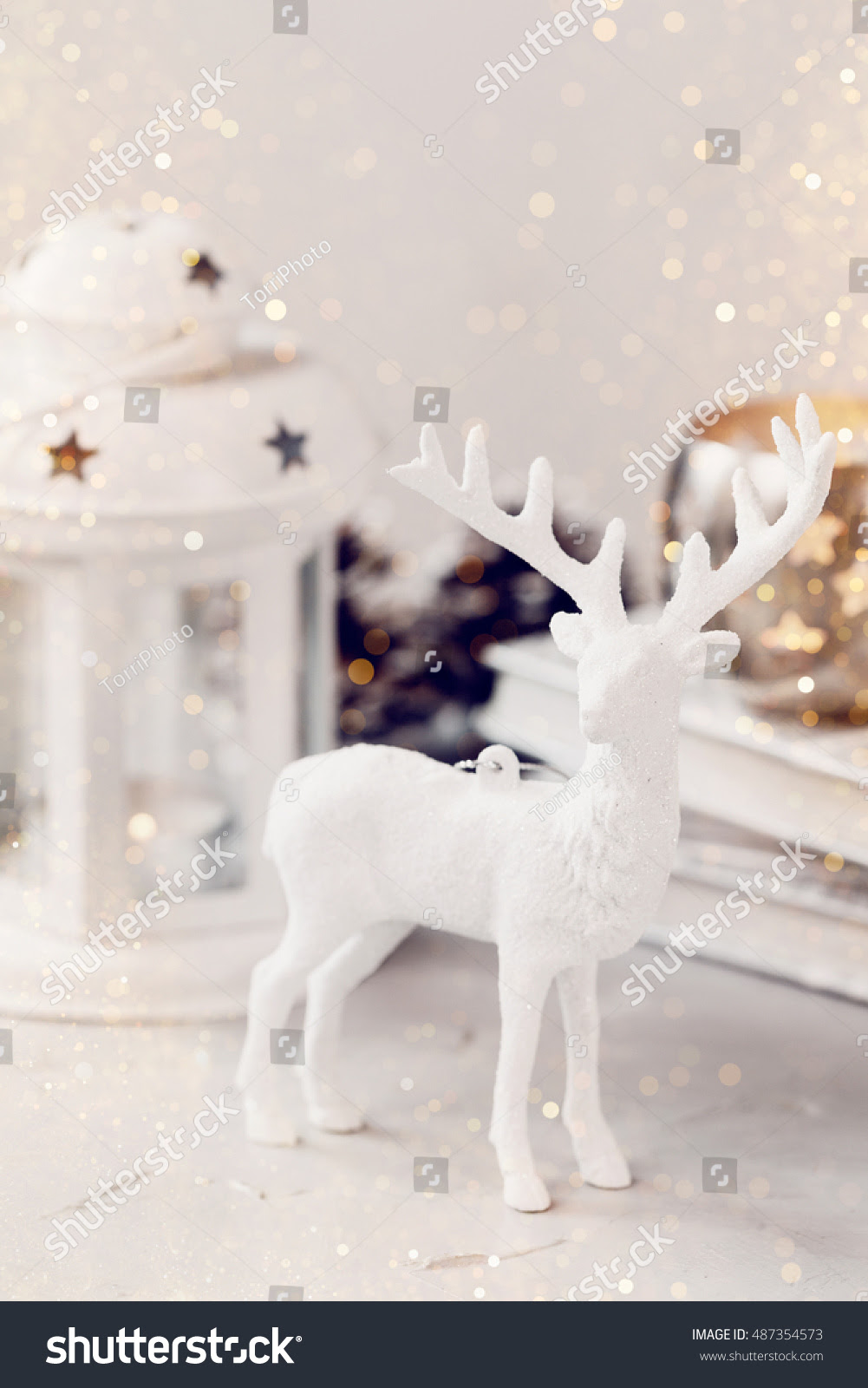 White deer Christmas decoration on light background. Christmas card