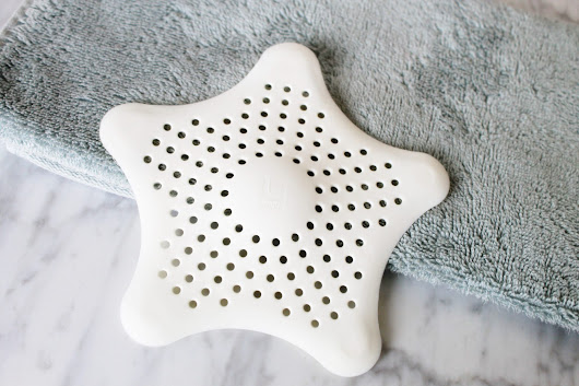 The Umbra Starfish Hair Catcher = Hair-Free Drains - Blush & Pearls