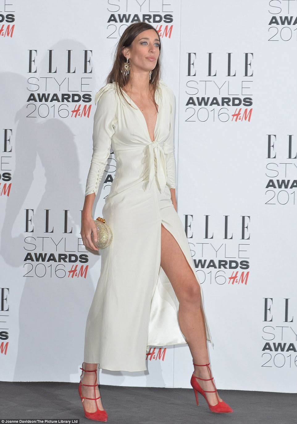 Leggy appearance: Take Me Out: The Gossip presenter Laura Jackson offset her white dress with red heels