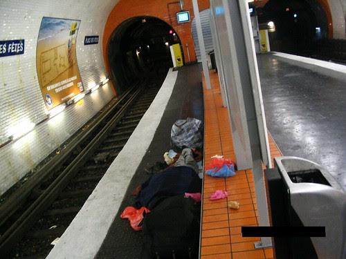 Homeless  guy sleeping on Métro