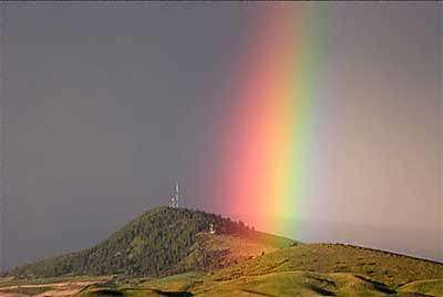 A rainbow touching down in the Palouse region of western Washington