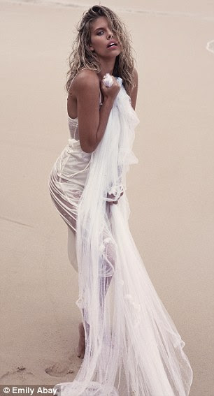 Style: The beauty posed in an array of elegant outfits including a floor length white gown