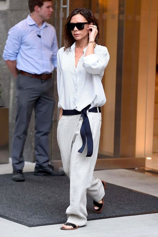 Le Fashion Blog Celebrity Style Victoria Beckham Oversized Sunglasses Button Down Shirt Gold Watch Slouchy Trousers Ribbon Belt Black Flat Sandals Via Vogue